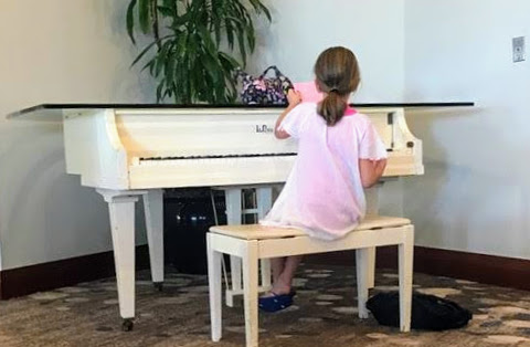 Student caught practicing piano while on vacation.